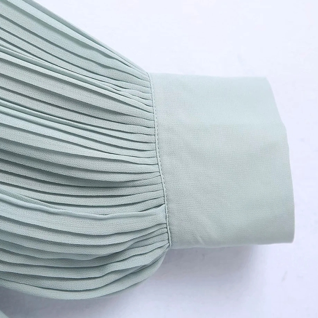 Shirt with cascading ruffle in pale green