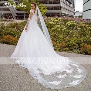 Image 2 - Adoly Mey Nieuwe Elegant Hals Volledige Mouw A lijn Trouwjurk 2020 Luxe Kralen Applicaties Hof Trein Bohemian Wedding Gown
