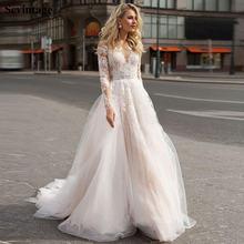 Платье свадебное кружевное в пол с длинными рукавами и открытой
