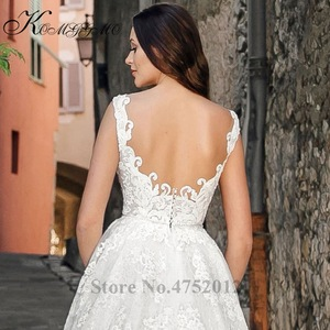 Image 2 - Volledige Kant Applicaties Backless Bridal A lijn Gown Vestidos De Novia Elegante V hals Mouwloze Trouwjurk
