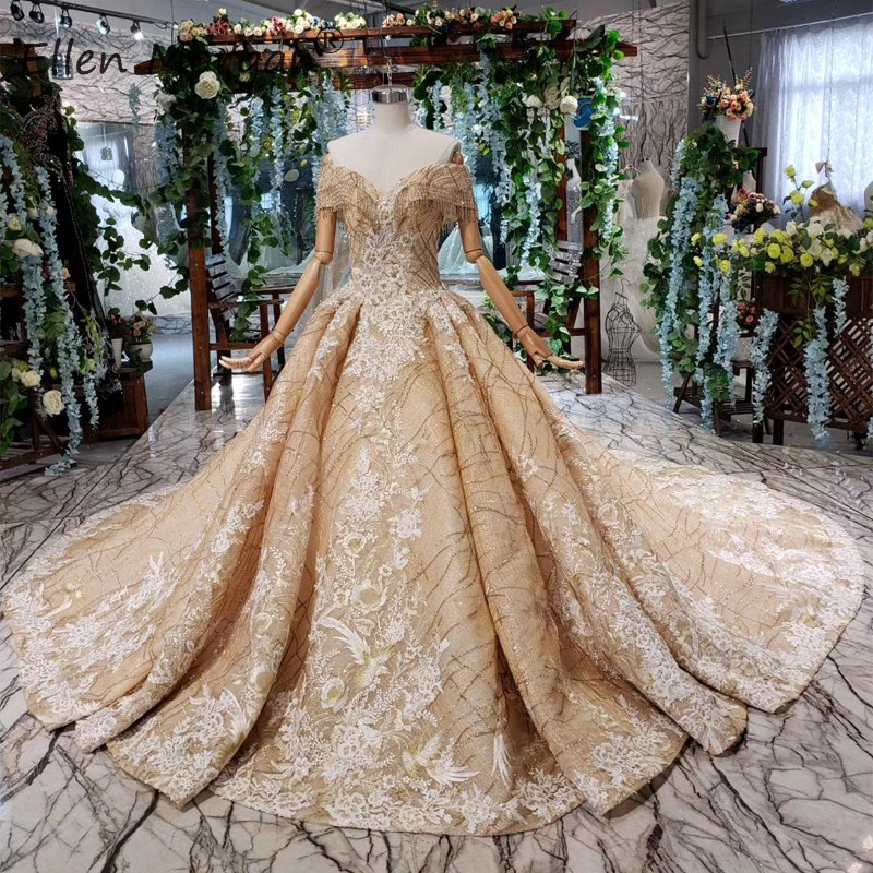 African Luxury Gold Lace Wedding Dresses Glitter Ball Gowns 2019 Off Shoulder Applique Sequins Court Train Bridal Dresses