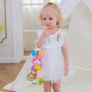 Image 2 - OLOEY תינוק יילוד עריסה עגלת תליית פעמוני צעצועי Teether בובת תינוק רעשן קטיפה מוקדם חינוך ילד ילדה בעלי החיים ארנב צעצוע