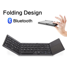 цена на Portable Mini foldable keyboard 64 keys Bluetooth Folding Wireless Keypad with Touchpad for iOS Android Windows