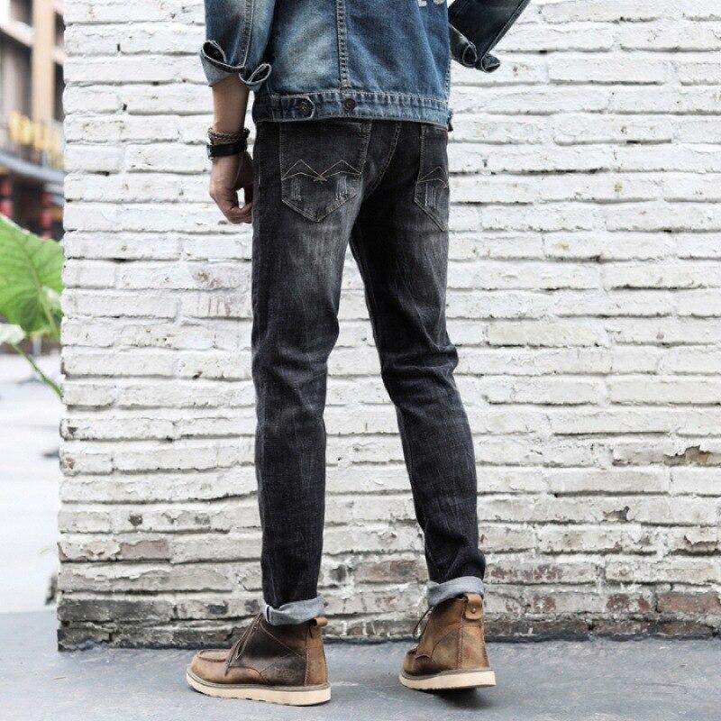 INS Super Fire Jeans Men Slim Fit Pants Medium Waist Elasticity Retro Ripped Pants [QQ Group: 584117172