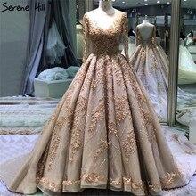 極端な高級ゴールドのウェディングドレス 2020 手作り花スパンコール長袖の花嫁衣装 BHA2184 カスタムメイド