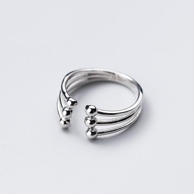 Фото модное глянцевое многослойное кольцо ginin из серебра 925 пробы