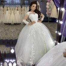 Свадебное платье с длинным рукавом и кружевной аппликацией свадебное