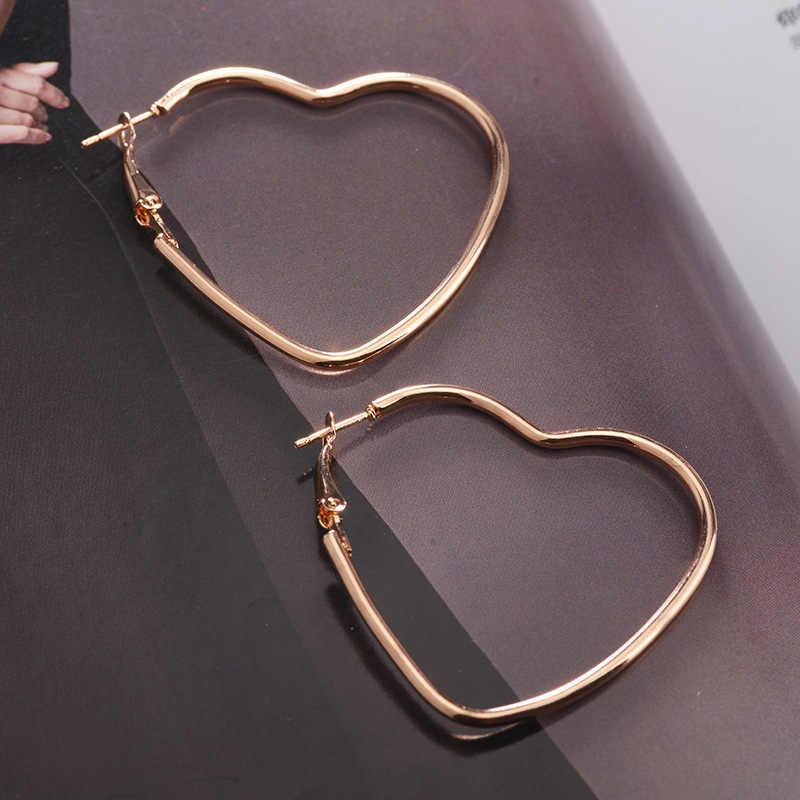 Nuevos pendientes de moda europea y americana con forma de corazón en forma de corazón pendientes de regalo para chicas