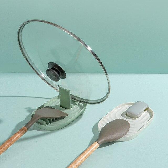Фото кухонный стеллаж для крышек шпателя домашняя кухонная посуда