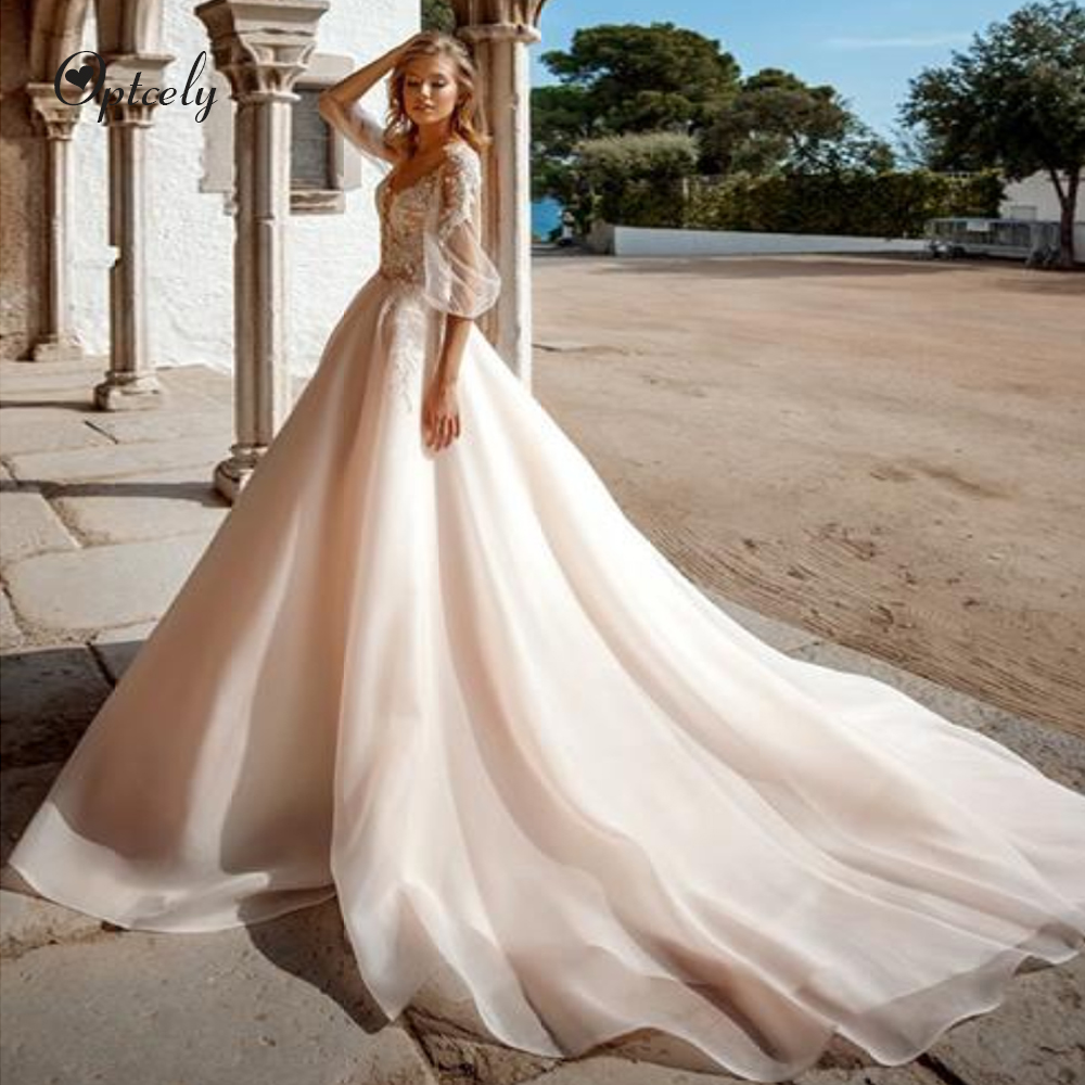 Optcely Luxury Chanpagne Backless A-line Wedding Dress 2019 Exquisite Scoop Neck Half Flare Sleeve Tulle Appliques Beading Gowns