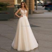 Boho שמפניה שמלות כלה 2020 אשליה קו V צוואר Applique פרחים ללא שרוולים באורך רצפת טול שמלות כלה זול