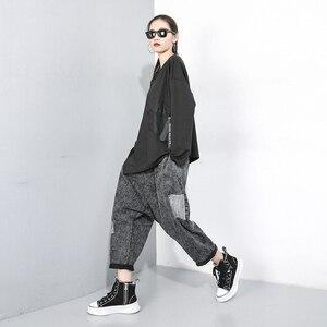 Image 3 - [Eem] kadınlar gevşek Fit cep boy eklenmiş düzensiz desenli tişört yeni yuvarlak boyun uzun kollu moda gelgit bahar sonbahar 2020 1D074