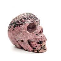 Hand carved natural rhodonite crystal skull pink gemstone crystal craft for decoration