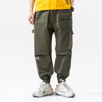 Hip-hopowe spodnie dresowe hafty styl japoński spodnie dresowe Streetwear mężczyźni biegacze spodnie dresowe na co dzień tanie i dobre opinie Asstseries Cargo pants Mieszkanie COTTON Luźne Hip Hop Midweight Płótno Pełnej długości Elastyczny pas