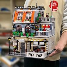 Criador especialista vista de rua ql0940 gardon hotel 1316 peças modelo modular moc blocos de construção tijolos grande emporium pet book shop