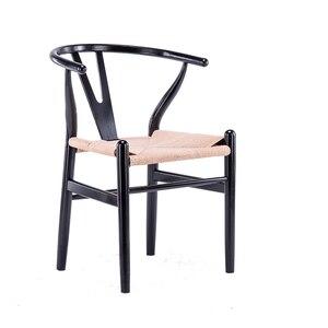 Silla de comedor de madera sólida nórdica Y taburete de descanso moderno minimalista creativo negro