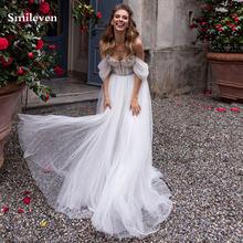 Свадебное платье в стиле бохо с объемными кружевными цветами