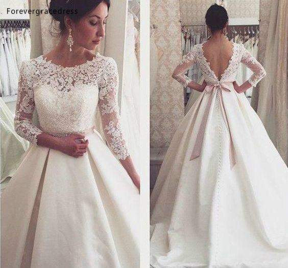 2019 Dubai Arabic 3/4 Long Sleeves Wedding Dress A Line Lace Appliques Backless Country Garden Bride Bridal Gown Custom Made