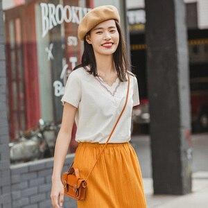 Image 3 - Novedad de Verano de 2020 INMAN, camiseta de manga corta bordada con personalidad y cuello en V combinable literaria de Color puro