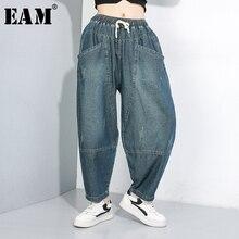 [EAM] di Alta Elastico Impiombato Denim Tasca Dei Pantaloni A Vita New Loose Fit Pantaloni Stile Harem Delle Donne di Modo di Marea di Autunno della Molla 2020 1B694