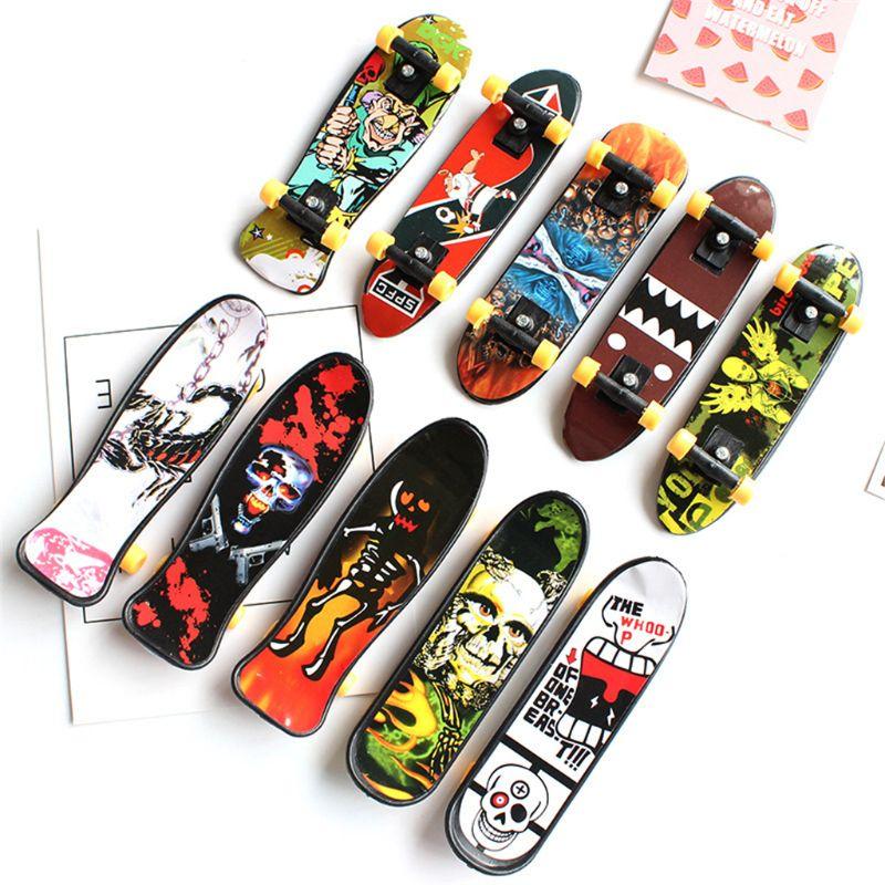 Cool Skull FingerBoard Mini Skateboard Kid Toy Party Favor Gift  Y4QA