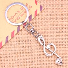 New Fashion Keychain 42x15mm Skull music Pendants DIY Men Jewelry Car Key Chain Ring Holder Souvenir For Gift(China)