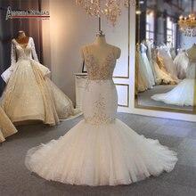Блестящее свадебное платье с юбкой годе от бренда amanda novias 2019