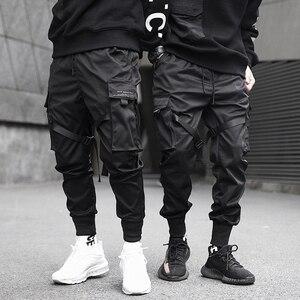 Image 1 - Moda uomo Multi Tasca Harem Pants Hip Hop Pant Nastri Pantaloni di Strada Harajuku Sweatpant Maschio Casual Tactical Cargo Pant