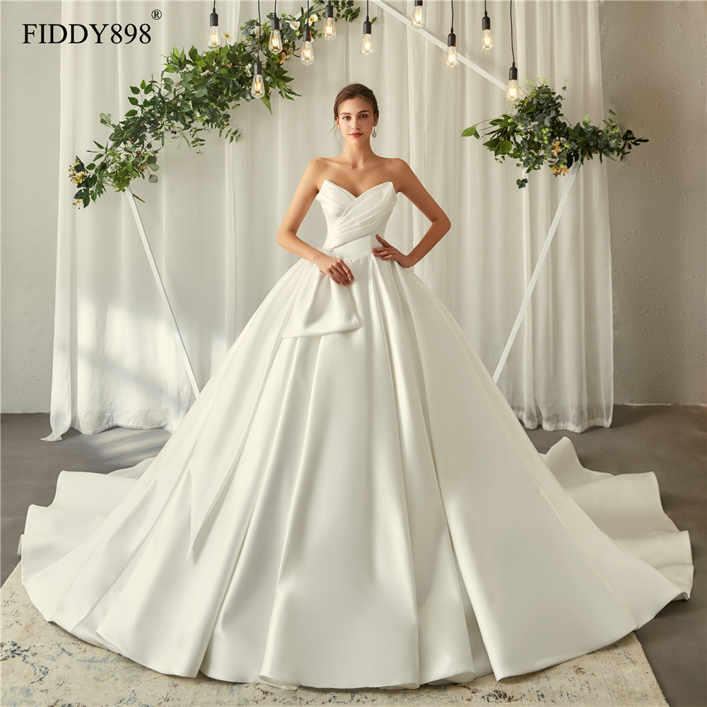 Royal Wedding Dresses 2020 V Neck Soft Satin Wedding Gown Puffy Ball Gown Ruffles Bridal Gown Long Train Vestido De Noiva