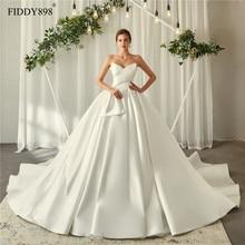 Royal Wedding Dresses 2020 V Neck Soft Satin Wedding Gown Puffy Ball Gown Ruffles Bridal Gown Long Train Vestido de Noiva