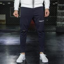 Dziura spodnie dla aktywnych męska odzież sportowa do kulturystyki Pantalon moda męska jogger fitness kulturystyka dorywczo spodnie rozciągliwe tanie tanio GYMCUCGV Ołówek spodnie COTTON Midweight ZTKC 28 34 - 34 65 Pełnej długości Na co dzień REGULAR Twill HOLE Sznurek