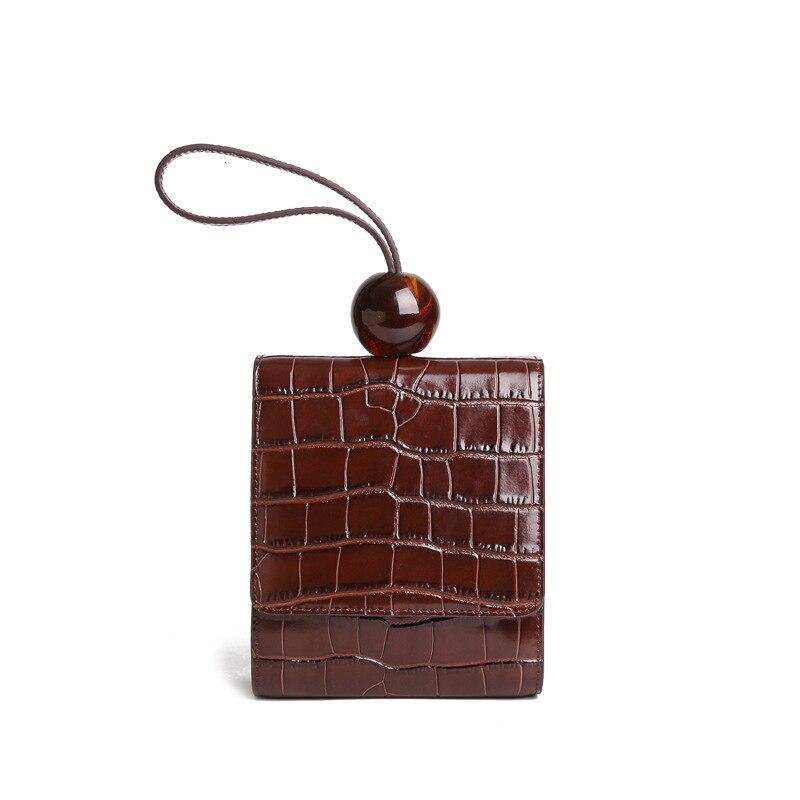 2019 nouveau sac pour femmes de luxe en peau de vache design rond perle sac à main couleur unie épaule sac de messager Crocodile motif dame sacs