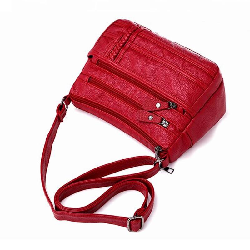 dm prime fênix bolsa de cor vermelha destaque da alça