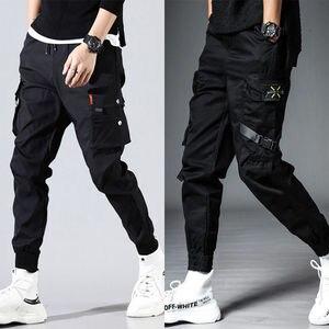 Image 2 - Erkek yan cepler Harem pantolon 2020 sonbahar Hip Hop rahat şerit tasarım erkek Joggers pantolon moda Streetwear pantolon siyah