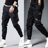 Hommes poches latérales sarouel 2020 automne Hip Hop décontracté rubans conception mâle Joggers pantalon mode Streetwear pantalon noir
