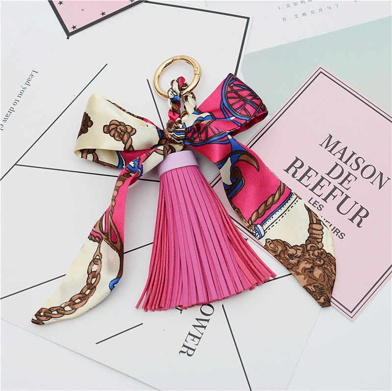 גבוהה באיכות אופנה צעיפי מפתח מחזיק סרט Bowknot מעודן עור מפוצל גדילים מחזיקי מפתחות נשים תיק קסם תליון