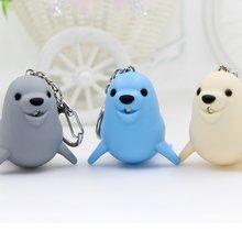 Llavero LED con forma de león marino para niños, llavero con sonido, minilinterna, forma de Animal, bolsa de juguete, accesorios de regalo
