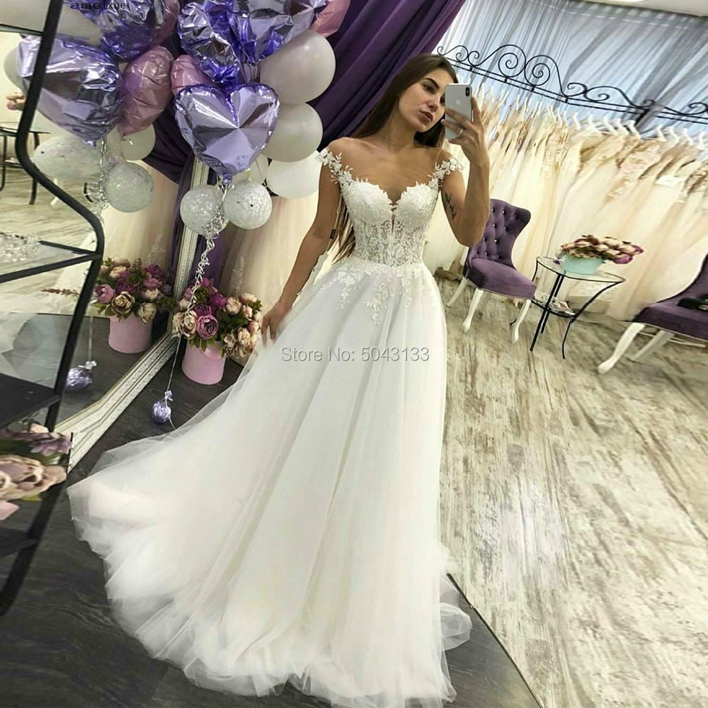 Sexy Sheer Scoop Neckline Cap Sleeves A Line Wedding Dresses 2020 Lace Bodice Ivory Applique Soft Tulle Floor Length Bridal Gown