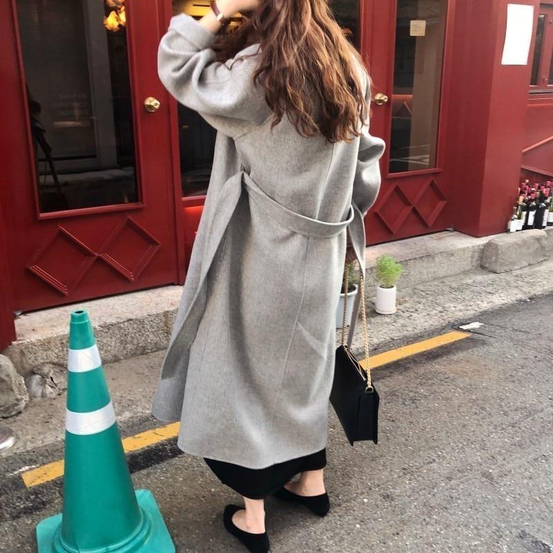 H4c5562c590584dd9925dfc4b45303c61R Winter Fashion Coats Women Wool-blend Coat Lazy Oaf Long Chunky Warm Coat Western Style Fitted Waist Lace-up Loose Coat