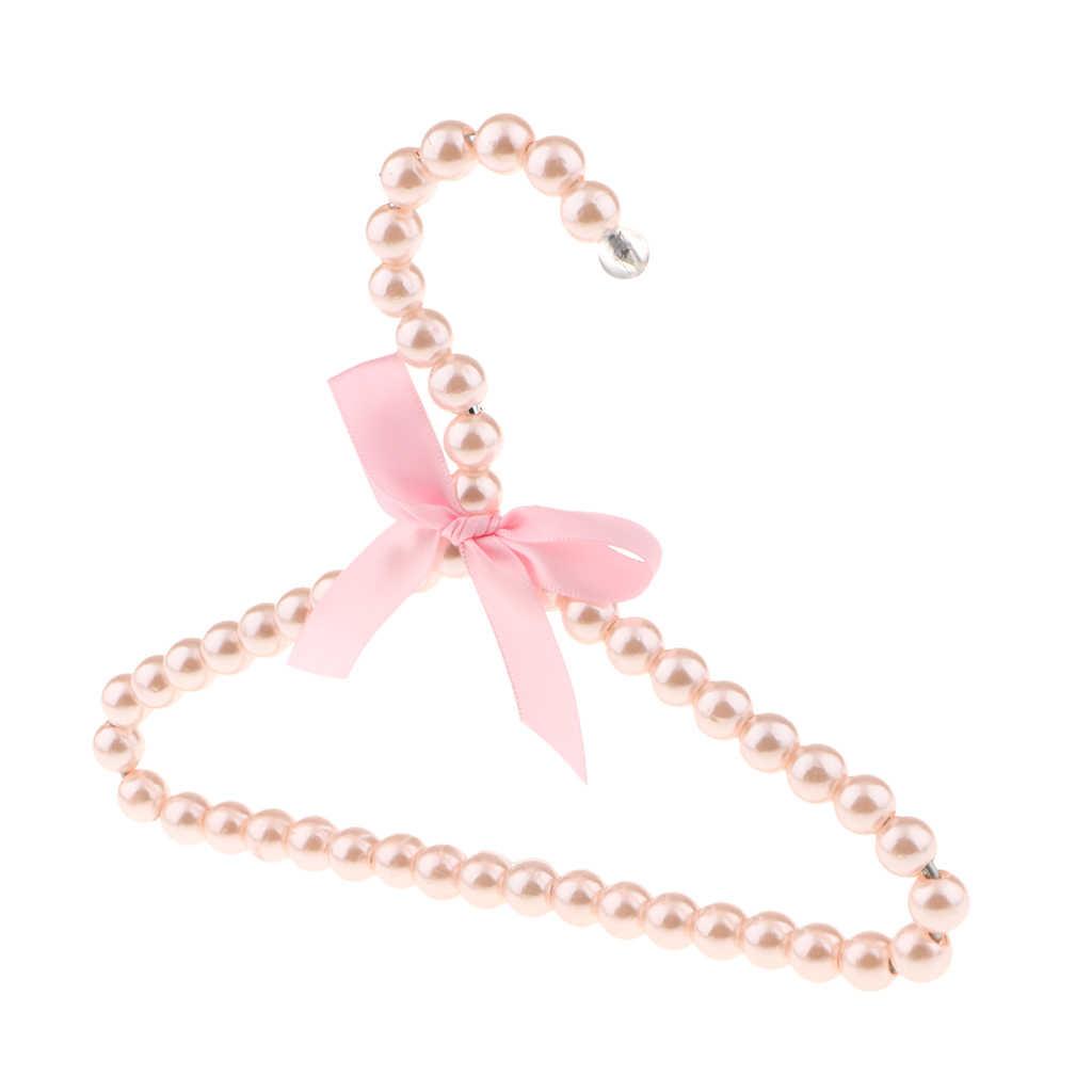 Percha de plástico de perlas blancas con cuentas para ropa con cinta de lazo anudado falda para pantalones 20cm organización del hogar