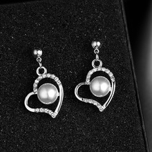 2020 Korean version of the creative pearl rhinestone earrings wild geometric round star and moon earrings