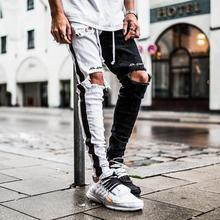 メンズファッションパンツヒップホップストリートステージ衣装歌手原宿ストリートジーンズ穴黒、白スリム男パンツ