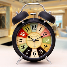 Students use bedside mute creative luminous simple bedroom retro light clock table decoration function sleepy table tool