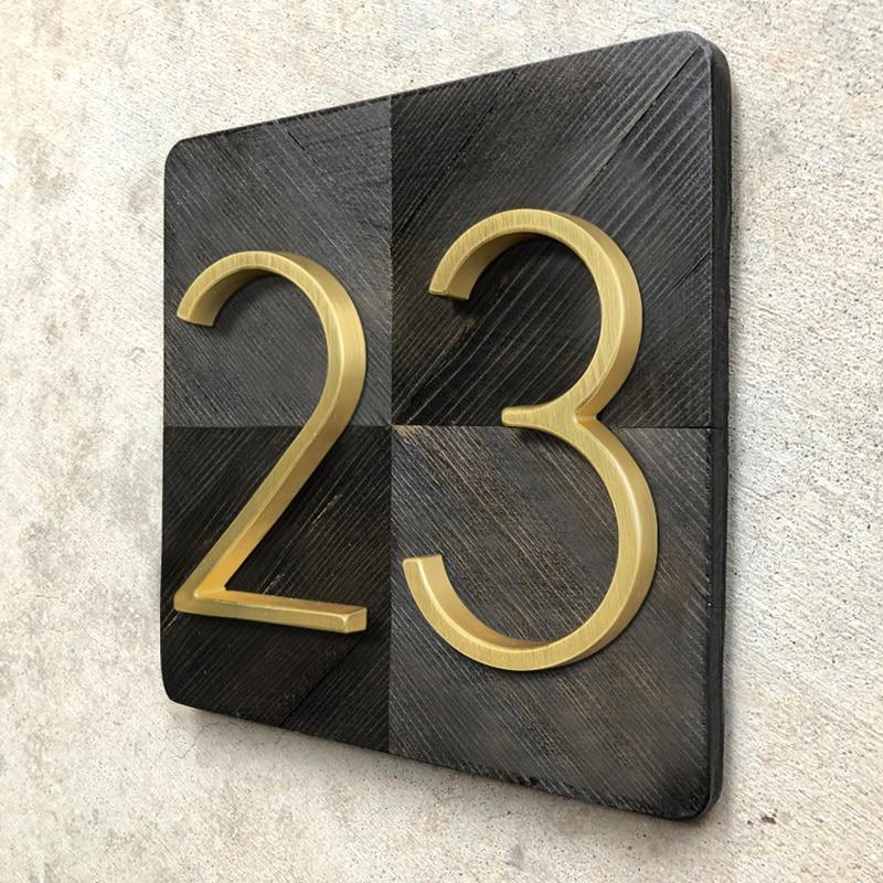 שלט מעוצב להצגת מספר דירה 1