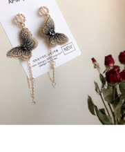 Super fairy butterfly earrings temperament long style European and American personality exaggerated tassel S925 silver