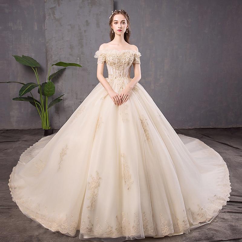 2020 limitée robe de mariée française légère 2020 nouvelles mariées se marier un mot épaule Net Style glisser queue princesse rêve fille