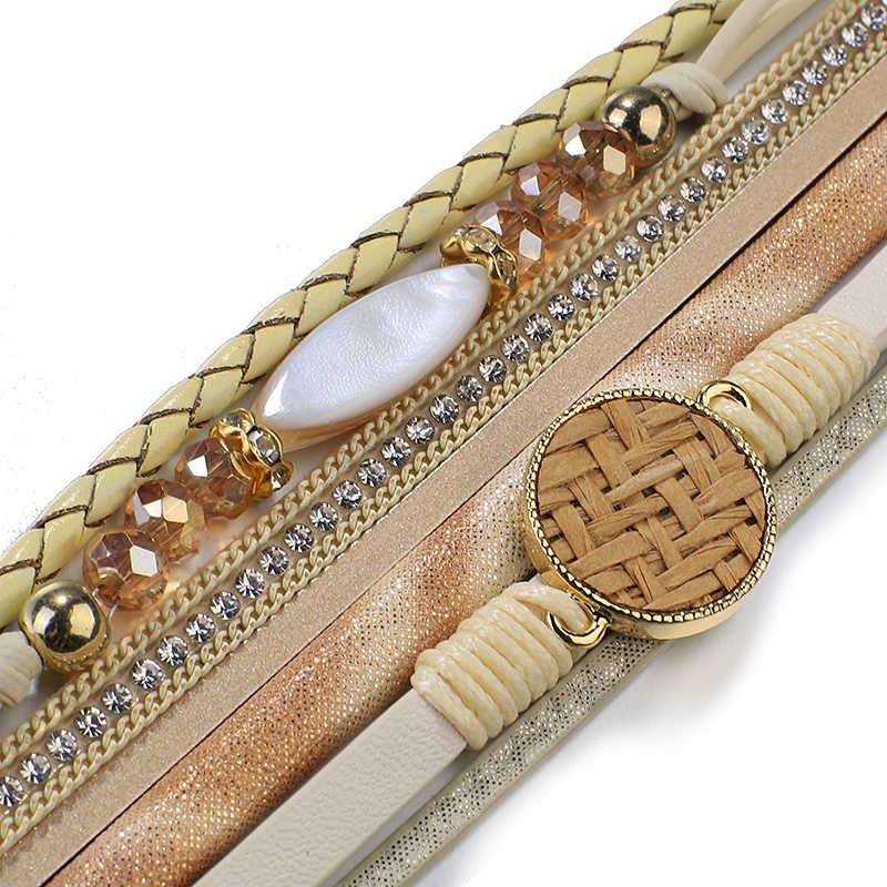 Amorcome ratán tejido de paja vid trenzada pulseras de cuero para las mujeres 2019 moda señoras Bohemia amplia pulsera con dijes envolvente joyería