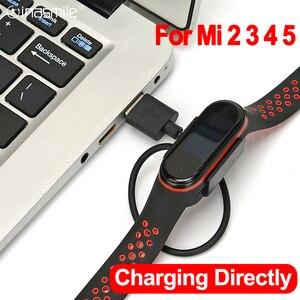 Image 1 - Зарядное устройство для Xiaomi Mi Band 2 3 4 5, зарядный кабель для передачи данных, док станция, зарядный кабель для Mi Band 5 4, зарядное устройство USB OTG адаптер