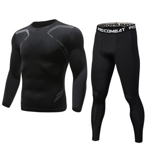 Brand 2pcs / sets men suit rashguard male kit MMA compression clothing male long-sleeved t-shirt + leggings tracksuit men