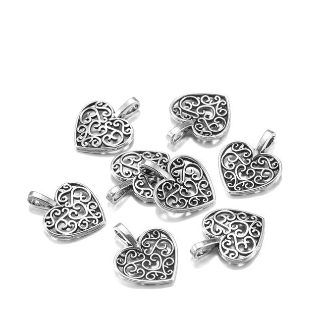 30pcs Antique Tibetan Silver Alloy Hollow Heart Charms Pendentifs conclusions Crafts